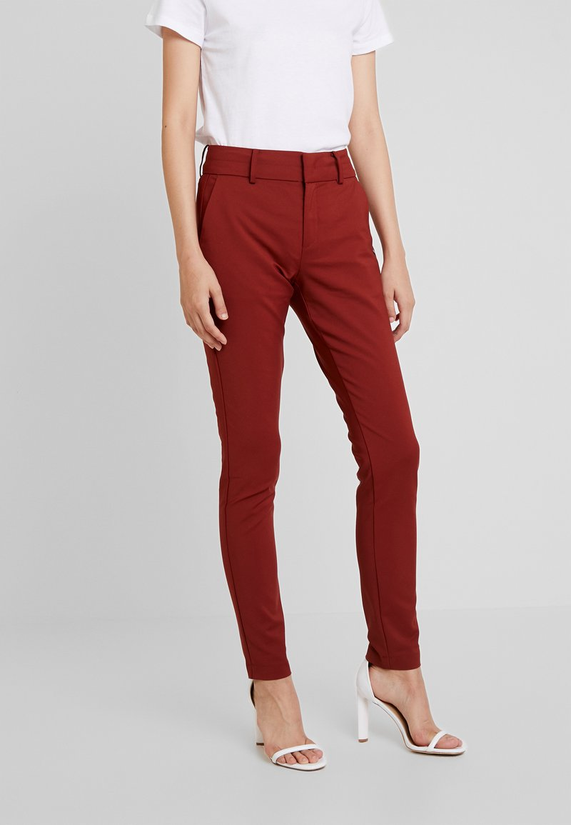 Nümph - BABASAN PANTS - Stoffhose - metalic red