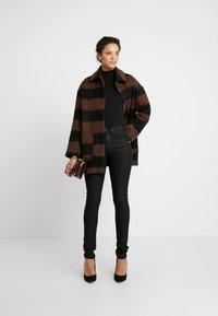 Nudie Jeans - HIGHTOP TILDE - Jeansy Skinny Fit - painted black - 1