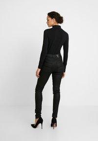 Nudie Jeans - HIGHTOP TILDE - Jeansy Skinny Fit - painted black - 2
