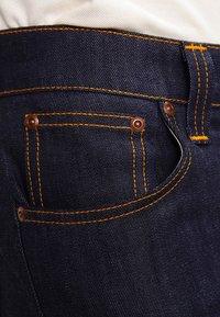 Nudie Jeans - THIN FINN - Slim fit jeans - organic dry ecru embo - 3