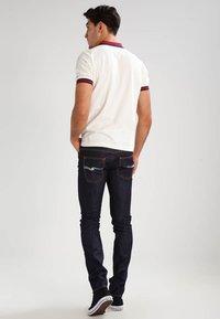Nudie Jeans - THIN FINN - Slim fit jeans - organic dry ecru embo - 2