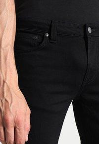 Nudie Jeans - SKINNY LIN - Jeans Skinny Fit - black denim - 3