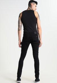 Nudie Jeans - SKINNY LIN - Jeans Skinny Fit - black denim - 2