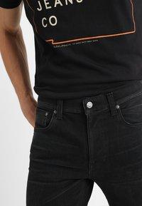 Nudie Jeans - LEAN DEAN - Slim fit jeans - authentic black - 3