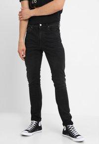 Nudie Jeans - LEAN DEAN - Slim fit jeans - authentic black - 0
