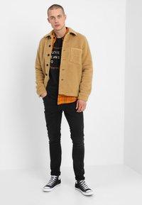 Nudie Jeans - LEAN DEAN - Slim fit jeans - authentic black - 1
