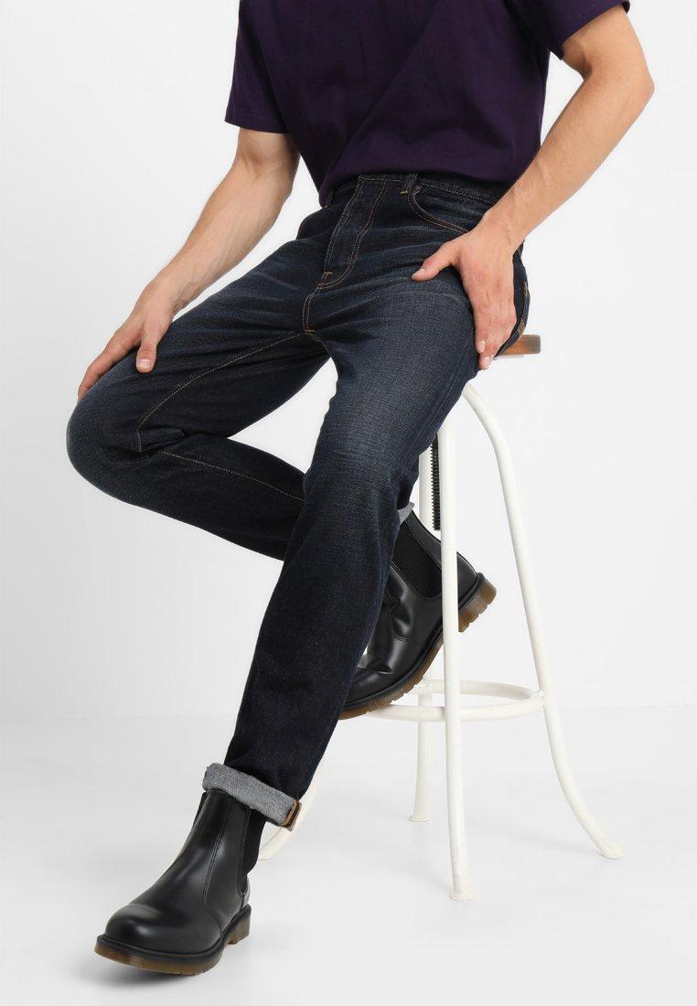 Nudie Jeans - FEARLESS FREDDIE - Relaxed fit jeans - dark scrapings
