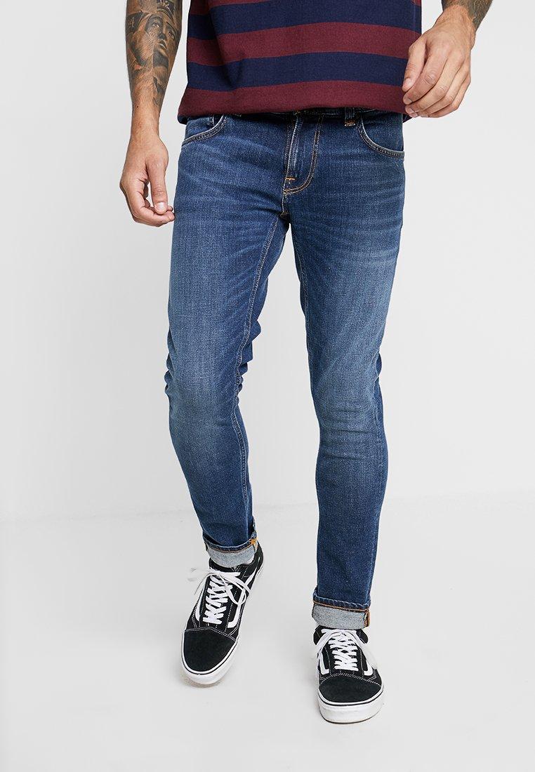 Nudie Jeans - TIGHT TERRY - Jeans Skinny Fit - mid blue orange
