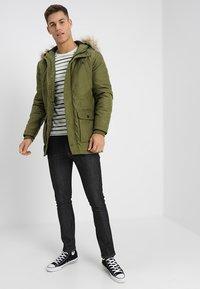 Nudie Jeans - LEAN DEAN - Slim fit jeans - dry tonal ecru - 1