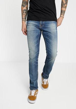 GRIM TIM - Jean slim - worn in broken