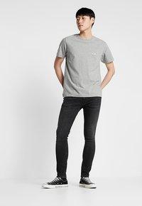 Nudie Jeans - TIGHT TERRY - Jeans Skinny Fit - black treats - 1