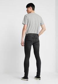 Nudie Jeans - TIGHT TERRY - Jeans Skinny Fit - black treats - 2