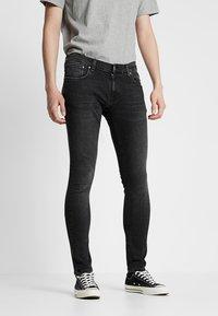 Nudie Jeans - TIGHT TERRY - Jeans Skinny Fit - black treats - 0