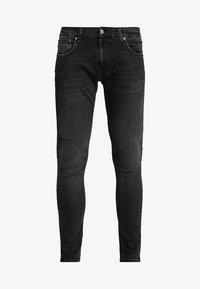 Nudie Jeans - TIGHT TERRY - Jeans Skinny Fit - black treats - 4