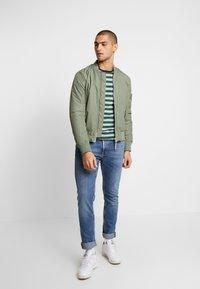 Nudie Jeans - LEAN DEAN - Slim fit jeans - lost orange - 1