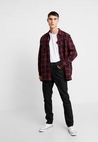 Nudie Jeans - LEAN DEAN - Slim fit jeans - black minded - 1