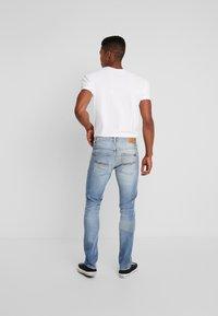Nudie Jeans - GRIM TIM - Slim fit jeans - crispy stone - 2