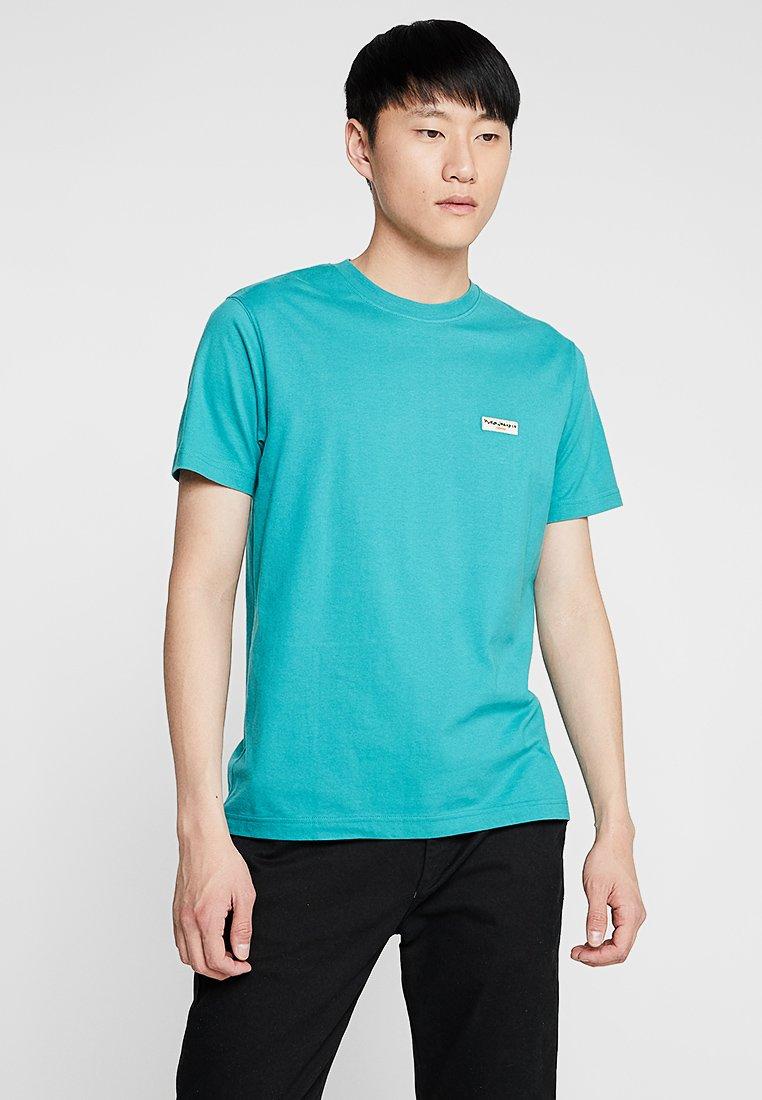 Nudie Jeans - DANIEL - Basic T-shirt - turquise