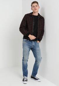 Nudie Jeans - SAMUEL - Sweatshirt - black - 1