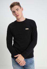 Nudie Jeans - SAMUEL - Sweatshirt - black - 0
