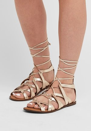 GLADIATOR - Ankle cuff sandals - gold