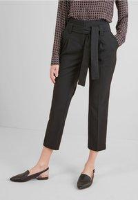 Next - Spodnie materiałowe - black - 0