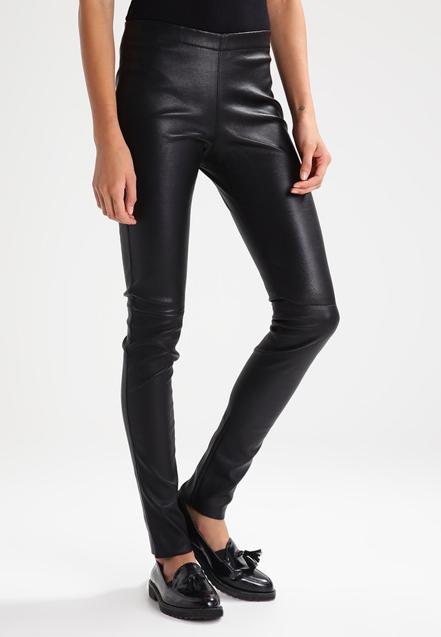 ASTEROID - Leather trousers - black