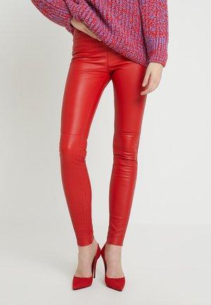 ANTARES - Pantaloni di pelle - red