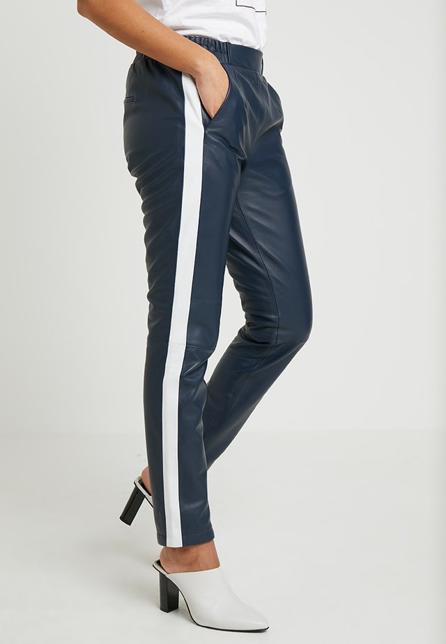 BELLA - Leather trousers - navy blue