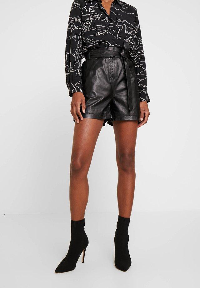CARMEN - Leather trousers - black