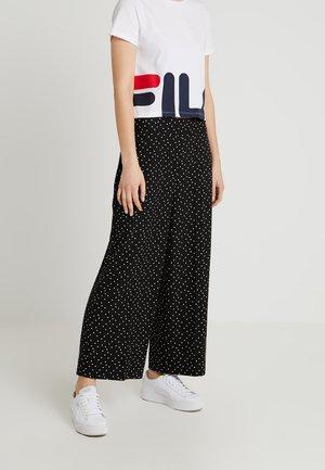 SPOT CROP WIDE LEG - Trousers - black/white