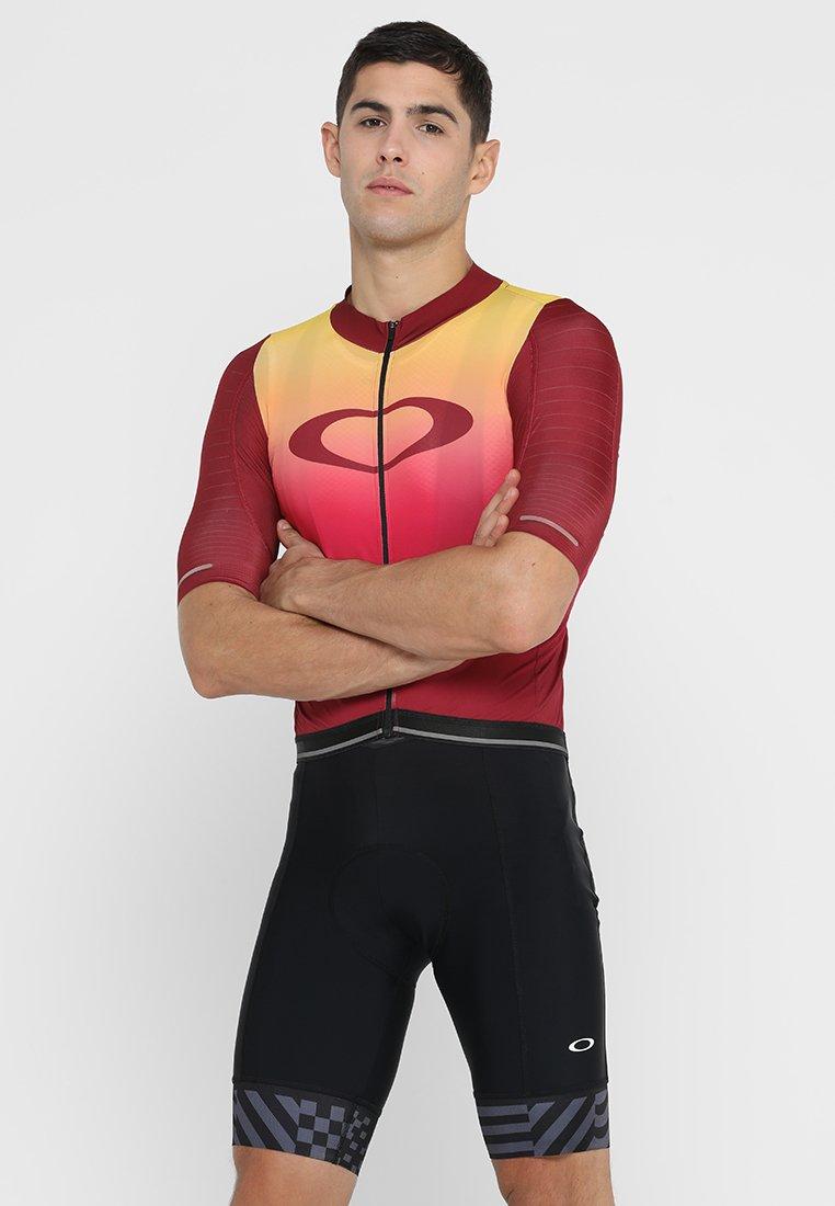 Oakley - AERO - Print T-shirt - red iridium
