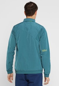 Oakley - IRIDIUM JACKET - Windbreakers - petrol