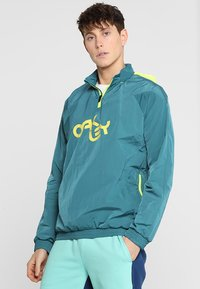 Oakley - IRIDIUM JACKET - Windbreakers - petrol - 0