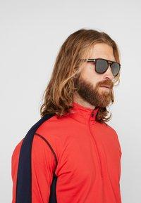 Oakley - LATCH BETA - Sunglasses - dark red - 1