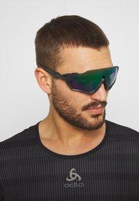 Oakley - FLIGHT JACKET - Sports glasses - steel/jade - 1