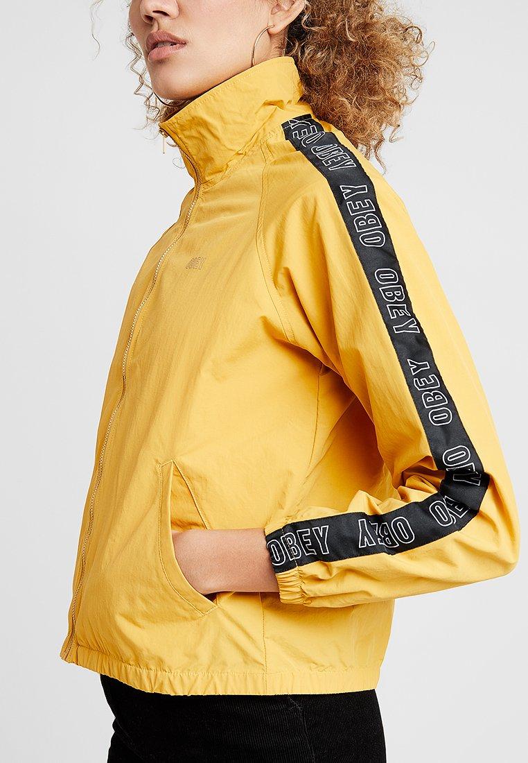 Obey Clothing JAX TRACK ZIP - Giacca leggera mustard