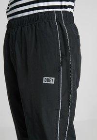 Obey Clothing - OUTLANDER PANT - Pantalon de survêtement - black - 5
