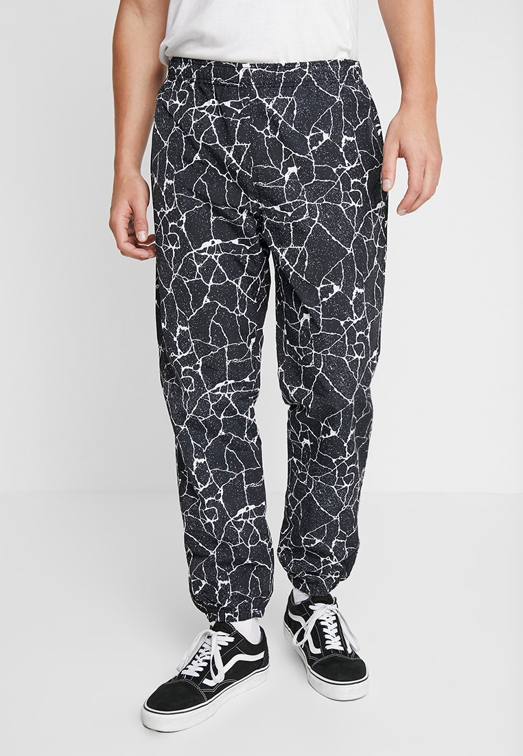 Obey Clothing - CONCRETE EASY PANT - Tracksuit bottoms - cracked black