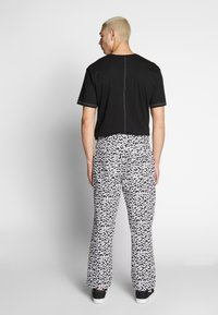 Obey Clothing - HARDWORK FUZZ PANT - Relaxed fit jeans - black multi - 2