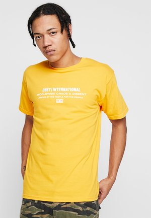 JUSTICE BY THE PEOPLE - T-shirts print - gold