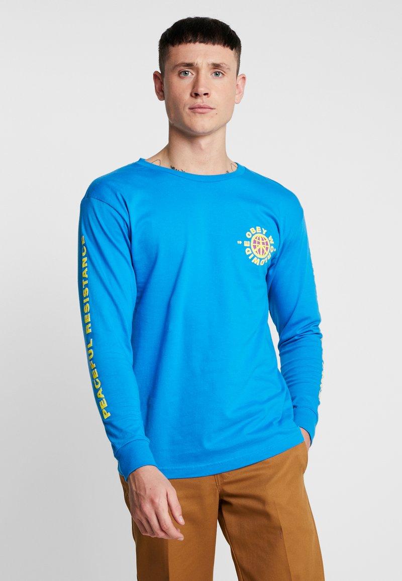 Obey Clothing - PEACEFUL RESISTANCE - Camiseta de manga larga - sky azure
