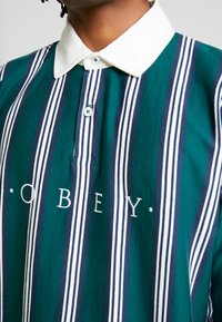 Obey Clothing - FIRM CLASSIC - Piké - dark teal/multi - 4