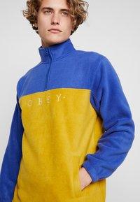 Obey Clothing - CHANNEL MOCK NECK - Bluza z polaru - gold/multi - 4