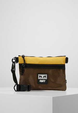CONDITIONS SIDE BAG - Across body bag - energy yellow