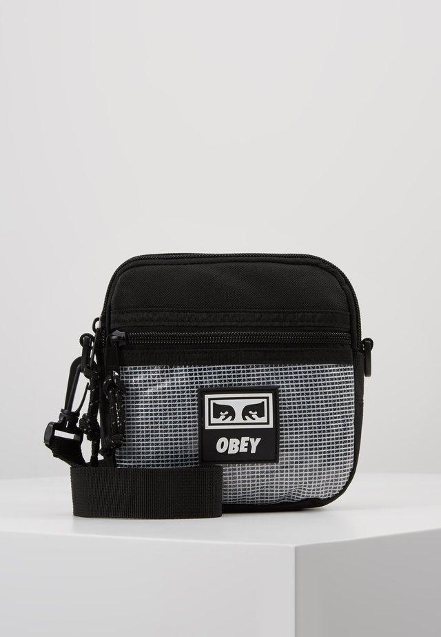 CONDITIONS TRAVELER BAG  - Across body bag - black
