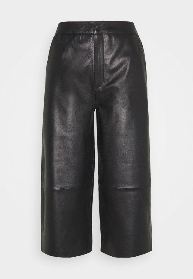 OBJVIOLA L CULOTTE - Leather trousers - black