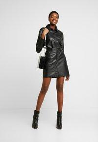 Object - OBJKASANDRA SKIRT - Falda de cuero - black - 1