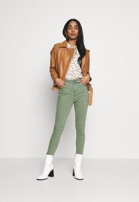 Object - OBJNANDITA JACKET SEASONAL - Leather jacket - sugar almond - 1