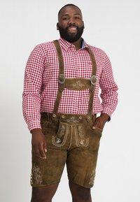 Stockerpoint - BEPPO BIG NEW - Kožené kalhoty - havanna - 0